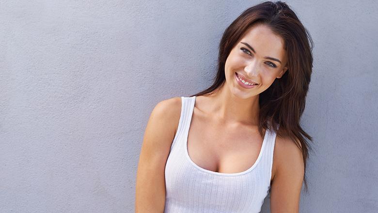 smiling woman wearing white tank top