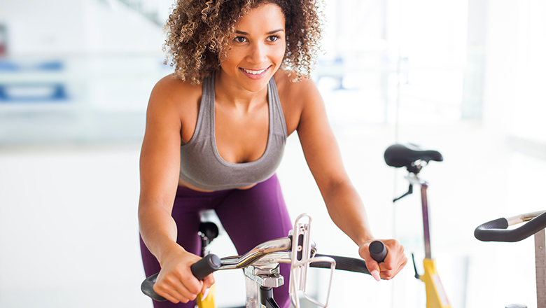 woman using exercise bike