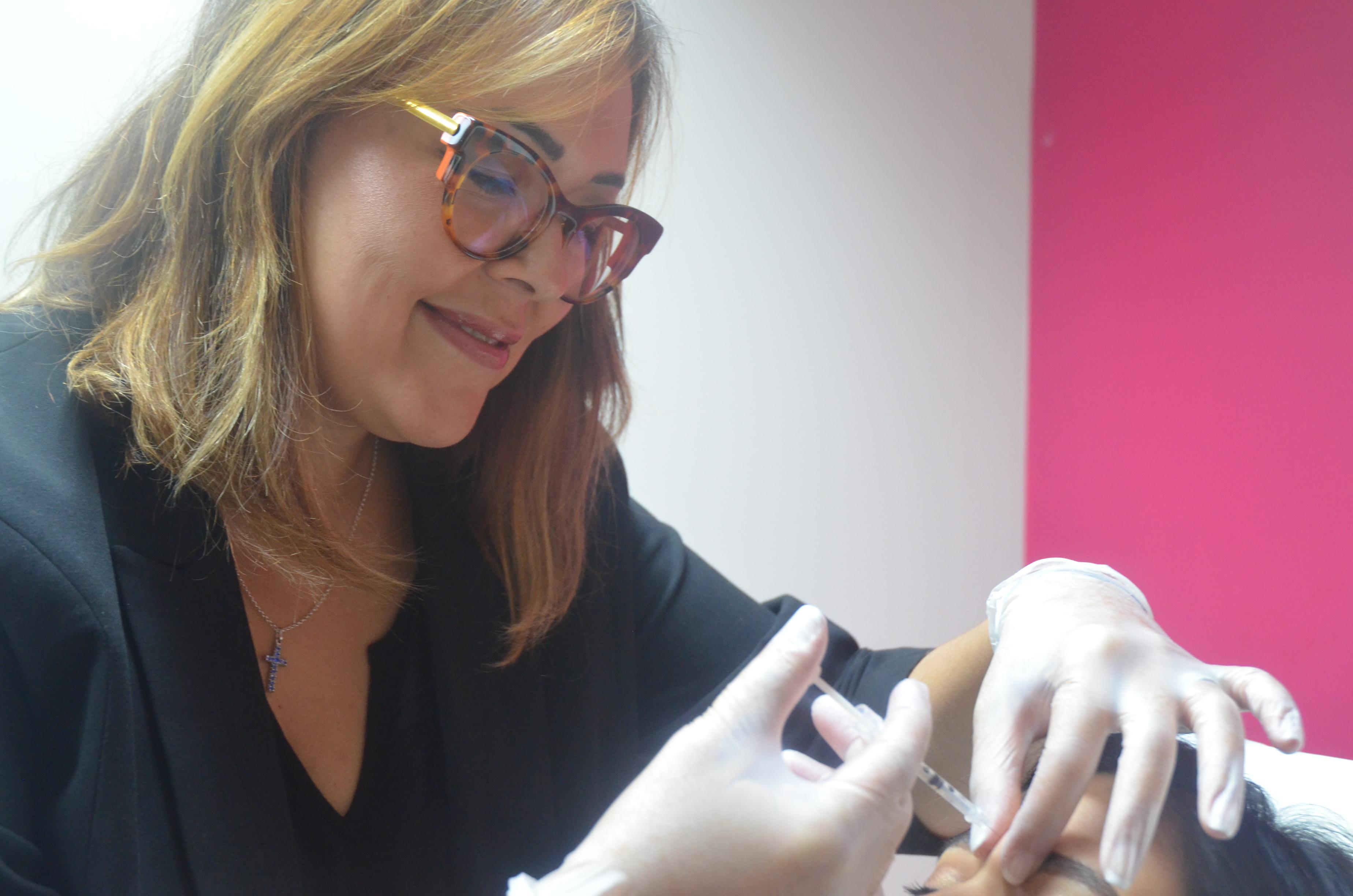 Nurse Taryn injecting a patient