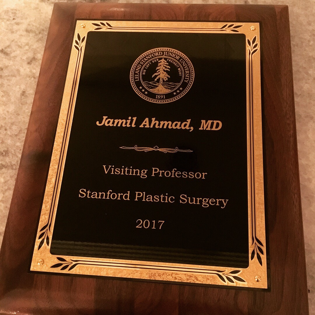 Dr. Ahmad gets rewarded with visiting Professor Stanford Plaque