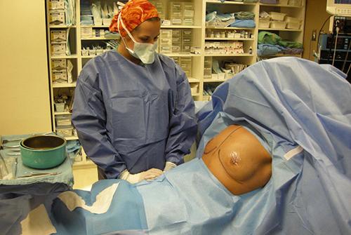 Why do we do breast augmentation sitting up?