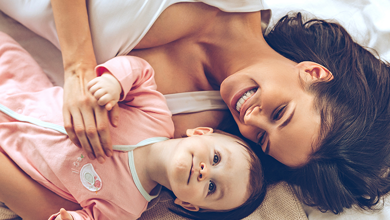 woman lounging with her baby