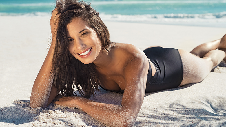 happy woman on beach in summer