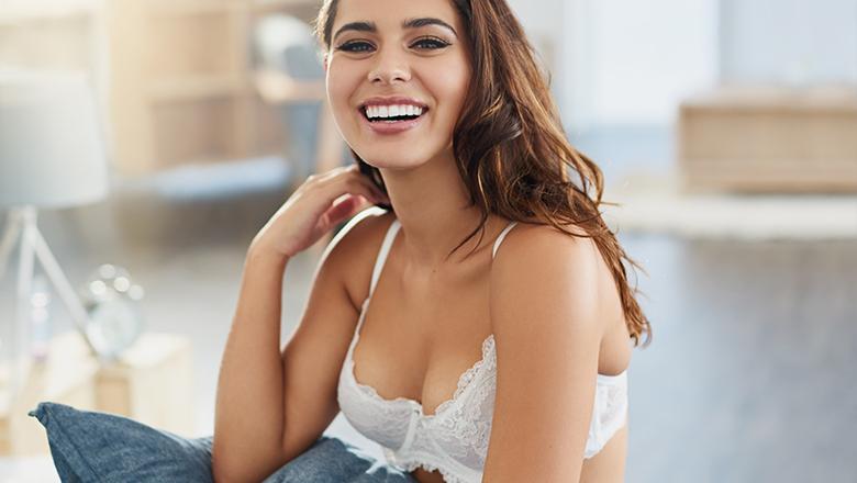 smiling woman wearing a bra