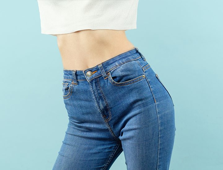 photo of a woman with a flat tummy in jeans