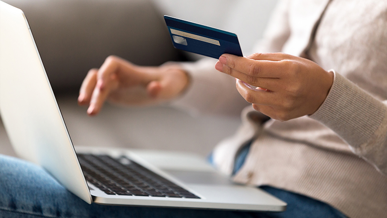 photo of a woman with a credit card and laptop